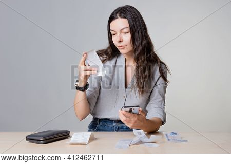 Personal Finance, The Frustrated Woman Considers The Costs, Receipts And Invoices,
