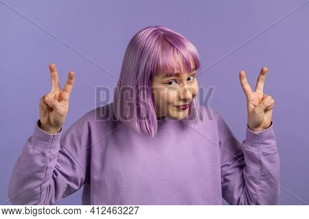 Pretty Woman With Dyed Purple Hair Showing With Hands And Two Fingers Air Quotes Gesture, Bend Finge