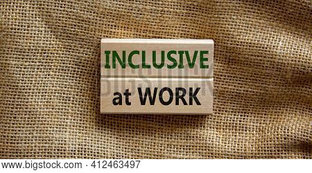 Inclusive At Work Symbol. Wooden Blocks With Words 'inclusive At Work' On Beautiful Canvas Backgroun