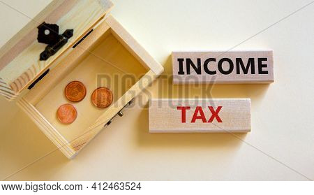 Income Tax Symbol. Concept Words 'income Tax' On Wooden Blocks On A Beautiful White Background. Smal