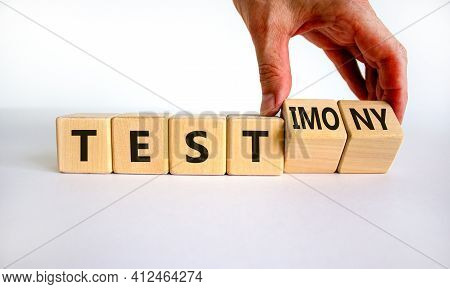 Test Or Testimony Symbol. Businessman Turns Wooden Cubes And Changes The Word 'test' To 'testimony'.