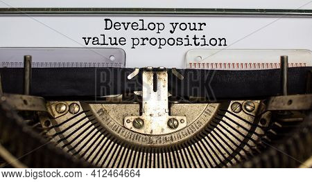 Develop Your Value Proposition Symbol. Words 'develop Your Value Proposition' Typed On Retro Typewri