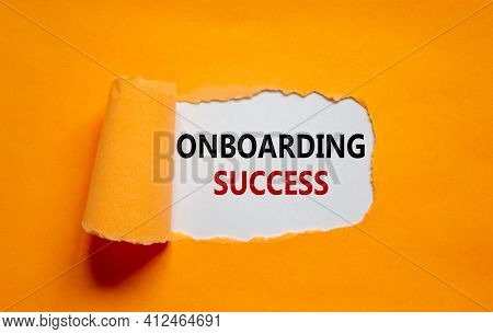 Onboarding Success Symbol. Words 'onboarding Success' Appearing Behind Torn Orange Paper. Beautiful