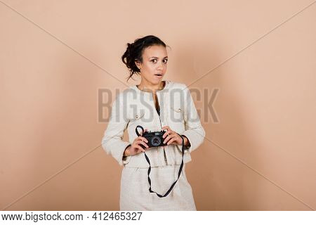 Attractive African American Black Female, Using A Slr Digital Camera Taking Photographs In Studio. P