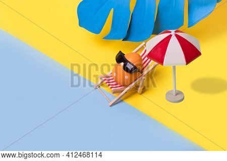 Minimal  Funny Composition With Easter Egg With Sunglasses Sitting On Deck Chair And Sun Umbrela On