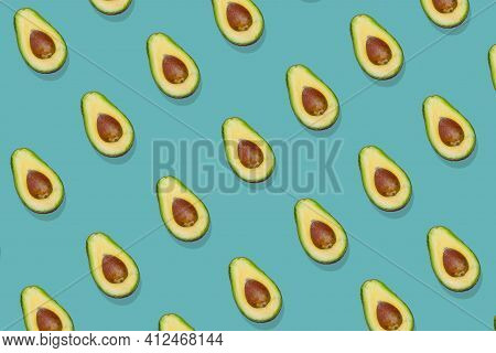 Trendy Avocado  Pattern On A Green Background.