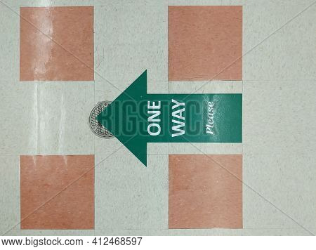 Floor Sign Indicating Restricted Hallway Or Aisle Travel During Corona Virus Pandemic