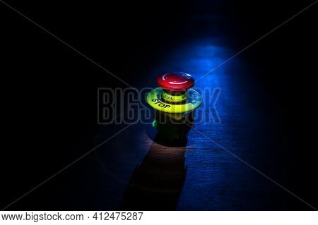 Emergency Stop Button, Disaster Protection. Industrial Concept. Red Button On Table In Dark Low Key