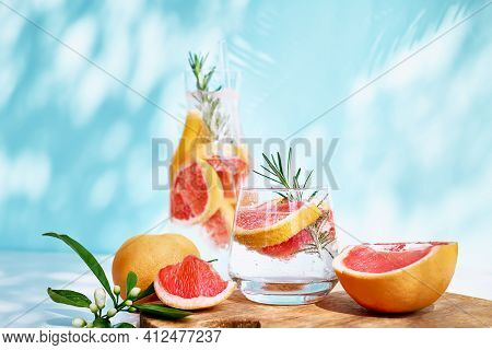 Summer Cocktail With Grapefruit And Rosemary And Juicy Slices Citrus Fruits. Fresh Healthy Grapefrui