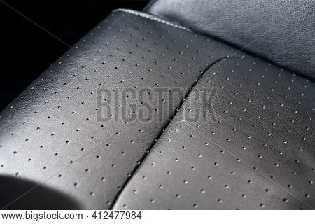 Close-up Detail View Of Modern Black Perforated Dotted Ventilated Luxury Car Seat. Part Of Dark Vehi