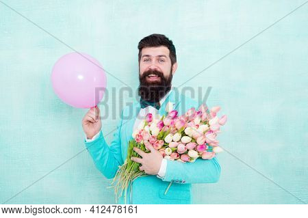 Bearded Man Hipster With Flower Bouquet. Greetings Concept. 8 March. Flower Bouquet For Womens Day.