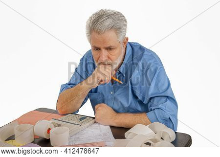 Horizontal Shot Of An Older Man Working On His Taxes.  This Is A Revised Image.