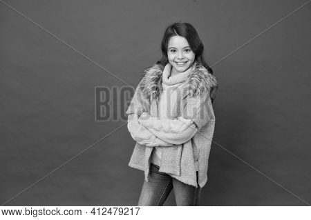 Smiling Kid Feel Comfortable In Autumn Seasonal Knitwear Clothes On Red Background, Copy Space, Cozy