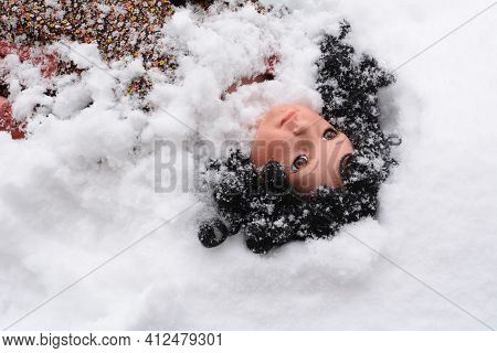 Girl Doll With Black Curly Hair Getting Buried By Snow In  Blizzard
