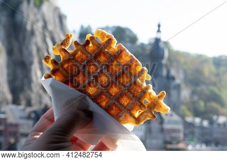 Eating Of Sweet Fresh Baked Belgian Waffles Served Outdoor With View On Maas River In Dinant, Wallon