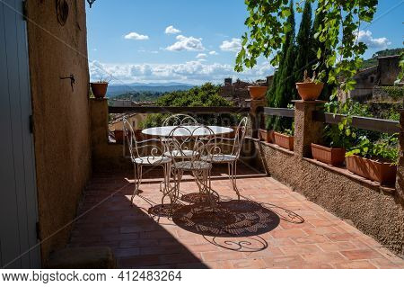 Travel Destination, Iron Table And Chairs In Small Ancient Village Cotignac In Provence, Surrounded