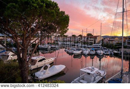 View On Houses, Roofs, Canals And Boats In Port Grimaud, Var, Provence, France During Sunset
