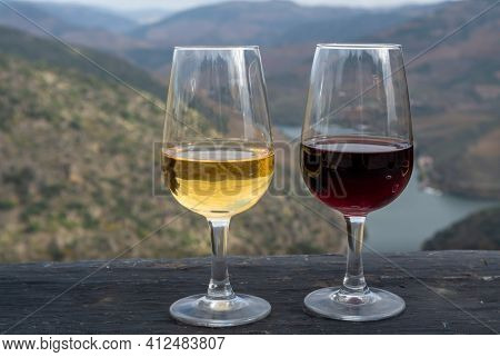 Glasses Of Portuguese Fortified Port Wine, Produced In Douro Valley And Douro River With Colorful Te