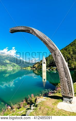 Submerged Bell Tower Of Curon On Lake Reschen In South Tyrol, Italy