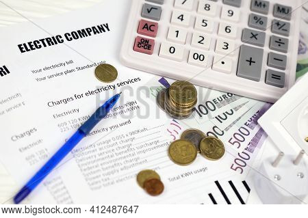 Calculator And Euro Bills With Pen On European Electricity Bill. Concept Of Saving Money By Using En