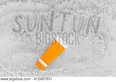 Sign Or Symbol Of Tan On The White Beach Sand With Sunscreen.