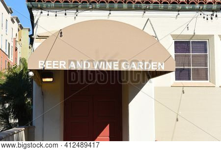 FULLERTON, CALIFORNIA - 24 JAN 2020: Beer and Wine Garden awning at the Fullerton Museum Center a weekly farmers market with live music and beer and wine tasting.