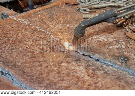 Checker Plate Cutting By Oxygen Acetylene Cutting Torch And Small Sparkle