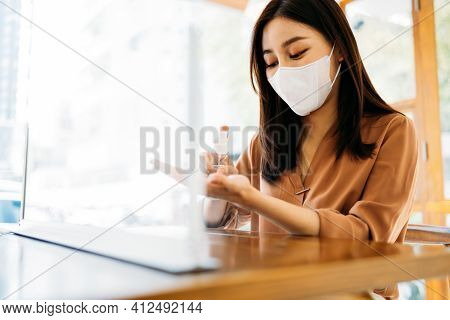 Young Beautiful Asian Woman Wearing Covid-19 Protective Face Mask Applying Medical Hand Sanitizer Fo