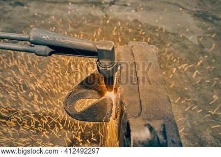 Center Frame Oxygen Acetylene Torch Cutting Car Part Or Auto Part On Chassis With Small Sparkle In V