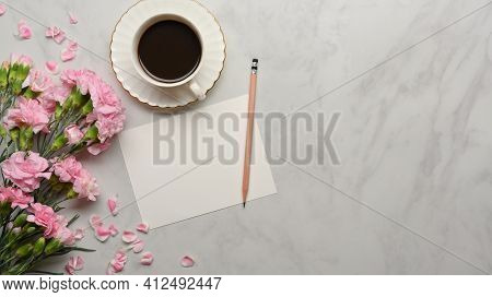 Marble Desk With Mock Up Paper, Pencil, Coffee Cup And Flower Decorated On The Table