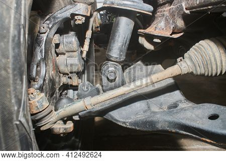 Lower Shock Absorber Bush And Bolt And Brake Caliper And Wheel Hub And Inner Tie Rod End And Outer T