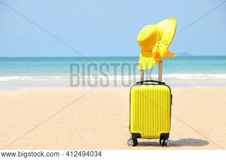 Travel On Summer And Tourist Planning With Yellow Suitcase With Yellow Hat Fashion In The Beautiful