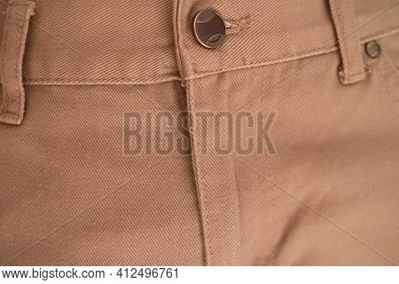 Close Up Of Brown Khaki Jeans Zipper, Denim Pant Button And Zippers
