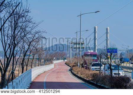 Daejeon, South Korea; March 8, 2021: Landscape Of Bike Path And Walking Trail Next To Roadway With B