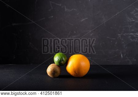 Figure From Different Fruits On A Black Background. Multi-colored Fruits On A Black Background. Roun