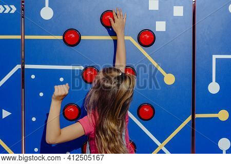 Dnepr, Ukraine- September 06, 2020: Young Girl Pushing Button On Game Machine In Entertainment Cente