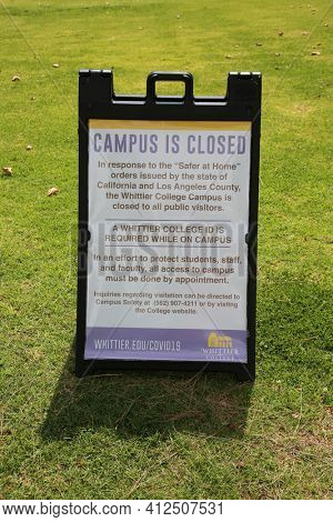 March 12, 2021 - Whittier, California: Whittier College. Coronavirus Campus Closed Sign. Campus is closed due to Covid-19. Sign on lawn. Editorial Use Only.