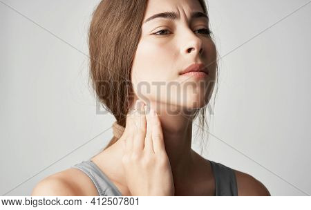 Woman In Gray T-shirt Health Problems Holds Hand Near Face Pain Discomfort
