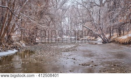 heavy snowstorm over Poudre RIver in northern Colorado, one of natural areas  in Fort Collins,