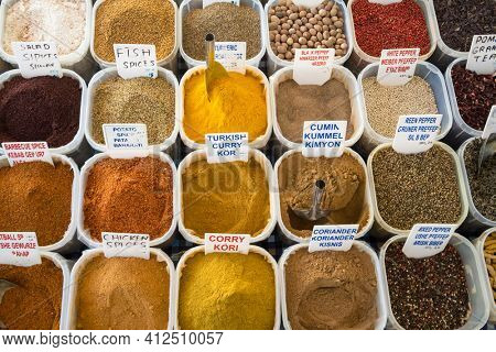 Variety of spices on traditional turkish bazaar. Lots of colorful spices on market in Turkey. Top view food background