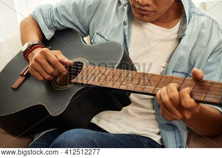 Cropped Image Of Talented Creative Young Man Playing Guitar At Home