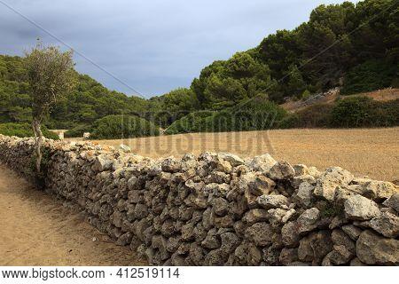 Sant Tomas, Menorca / Spain - June 25, 2016: A Dry Rock Wall Near Binigaus Beach, Sant Tomas, Menorc
