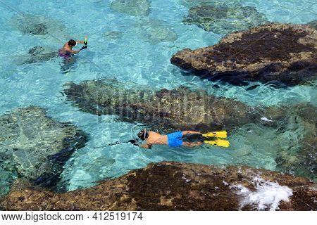 Es Migjorn Gran, Menorca / Spain - June 25, 2016: Clear Water And Snorkelers At Escorxada Beach, Es