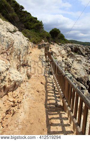 Es Migjorn Gran, Menorca / Spain - June 25, 2016: The Trail To Escorxada Beach, Es Migjorn Gran, Men