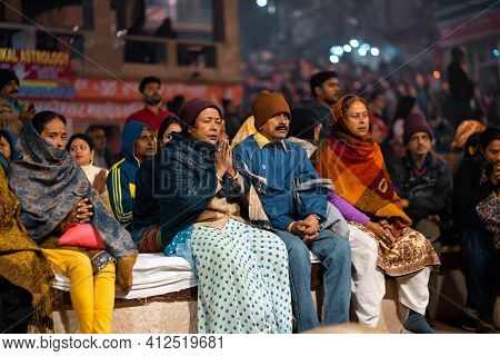 17.12.2019, Varanasi, India. The Sacred Religious Ceremony Of Arati. People Sits Praying And Watchin