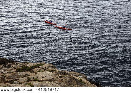 Es Migjorn Gran, Menorca / Spain - June 25, 2016: Canoeing At Escorxada Bay, Es Migjorn Gran, Menorc