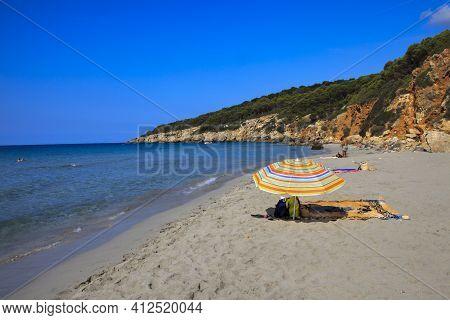 Sant Tomas, Menorca / Spain - June 25, 2016: A Beach Umbrella At Binigaus Beach, Sant Tomas, Menorca
