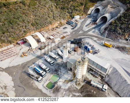 Concrete Mixer Trucks, Concrete Batching Plant And Construction Materials At Motorway Tunnel Constru