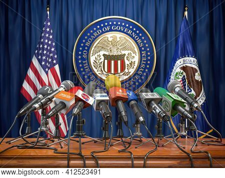 Federal Reserve System Fed of USA press conference concept. Microphones TV and radio channels with symbol and flag of US Federal Reserve. 3d illustration