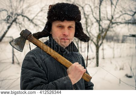 A Peasant With An Ax In Winter